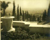 A.E Bell Gardens: terrace with relief planter looking down allée descending hillside [color scan]
