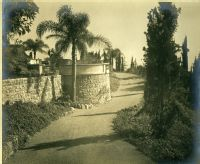 A.E Bell Gardens: driveway with stone wall [color scan]